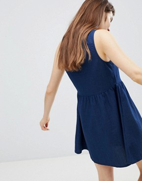 photo Polka Dot Button Through Smock Dress in Navy by Monki, color Blue - Image 2