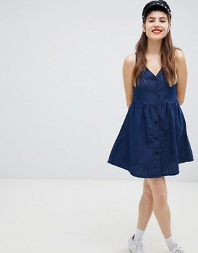 photo Polka Dot Button Through Smock Dress in Navy by Monki, color Blue - Image 4