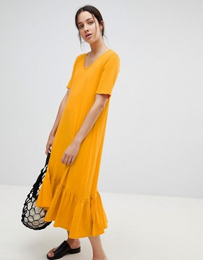 photo Building Block Midaxi Dress in Organic Cotton by Kowtow, color Marigold - Image 1