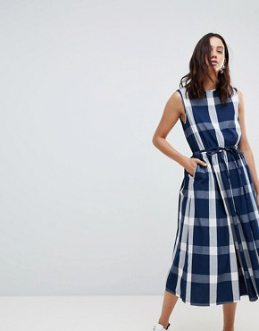 photo Dance with Me Organic Cotton Pinafore Dress by Kowtow, color Navy Check - Image 1