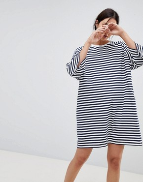 photo Oversized Striped T-Shirt Dress in Organic Cotton by Kowtow, color Navy White - Image 1