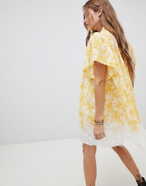 photo Marigold Print Tunic Dress by Free People, color Ivory - Image 2