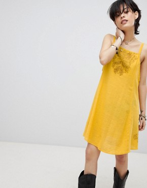 photo Tulum Cutwork Slip Dress by Free People, color Yellow - Image 1