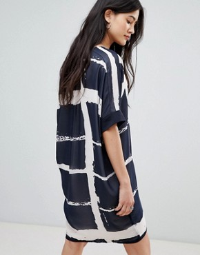 photo Tunic Shirt Dress in Fence Print by Religion, color Navy/White - Image 2