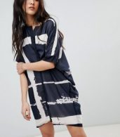 photo Tunic Shirt Dress in Fence Print by Religion, color Navy/White - Image 1