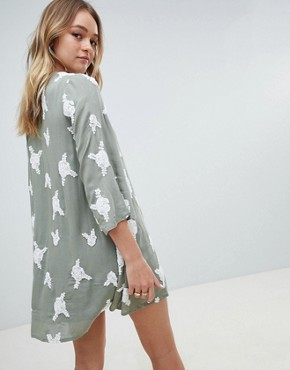 photo Swing Dress with All Over Embroidery by Honey Punch, color Dusty Sage Green - Image 2