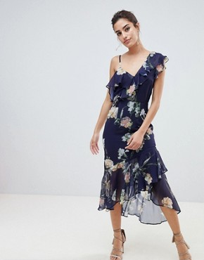 photo Floral Layered Shoulder Dress with Ruffle Asymetric Hem by Hope & Ivy, color Navy Floral - Image 1