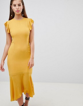 photo Lattice Back Pencil Dress with Ruffle by Hope & Ivy, color Ochre - Image 1