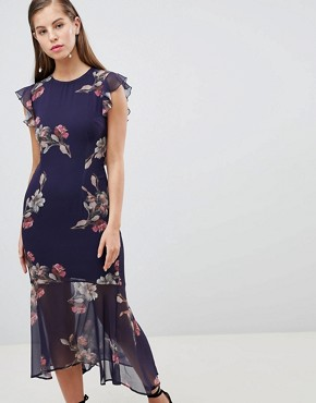 photo Floral Lattice Back Pencil Dress with Ruffle by Hope & Ivy, color Navy Floral - Image 1