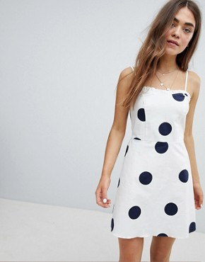 photo Cami Dress with Ruffle Detail in Polka Dot by Nobody's Child, color White Polka - Image 1