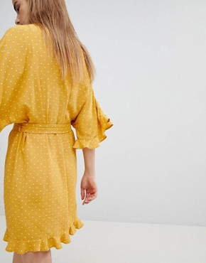 photo High Neck Mini Dress with Ruffle Hem Detail by Nobody's Child, color Yellow Polka - Image 2