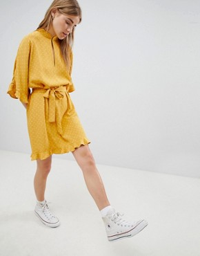 photo High Neck Mini Dress with Ruffle Hem Detail by Nobody's Child, color Yellow Polka - Image 1