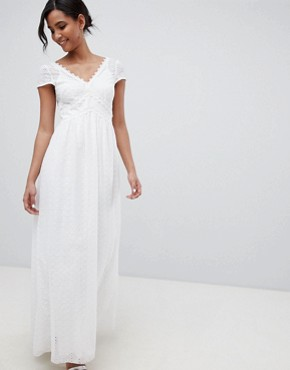 photo Allover Broderie Plunge Front Maxi Dress in White by Little Mistress, color White - Image 1