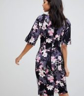 photo 3/4 Sleeve Wrap Front Bodycon Dress by Paper Dolls, color Print - Image 2