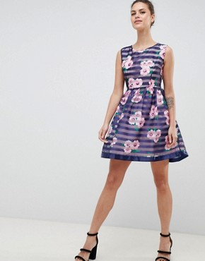 photo Floral & Striped Skater Dress by Zibi London, color Navy - Image 1
