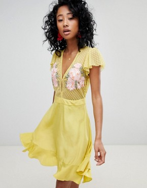 photo Ruffle Mini Dress with Floral Embroidery by Cleobella, color Chartreuse - Image 1