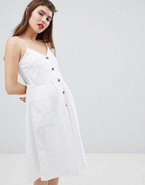 photo Pocket Front Midi Sun Dress by Monki, color White - Image 1