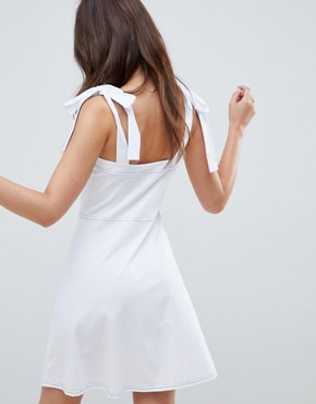 photo Button Through Contrast Stitch Mini Pinafore Sundress by ASOS DESIGN, color White - Image 2