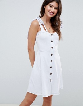 photo Button Through Contrast Stitch Mini Pinafore Sundress by ASOS DESIGN, color White - Image 1
