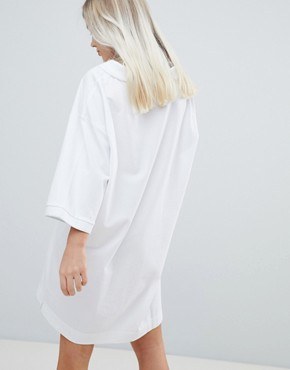 photo Pique Polo Dress in White by Weekday, color White - Image 2