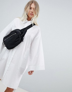 photo Volume Shirt Dress in White by Weekday, color White - Image 1