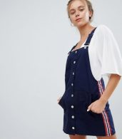 photo Dungaree Dress in Navy by Bershka, color Navy Blue - Image 1