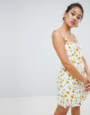 photo Dress with Frill Hem in Ditsy Floral by Honey Punch, color White - Image 1