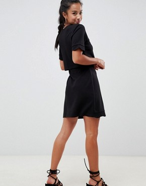 photo Scalloped Hem Mini Dress with Crop Top and Wrap Skirt by ASOS DESIGN Petite, color Black - Image 2